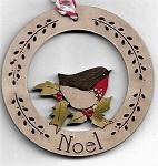 Robin among holly in Noel