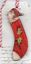 Santa in red stocking button 9cm