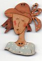 lady in straw coloured hat button