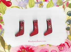 3 little red stockings 3cm tall